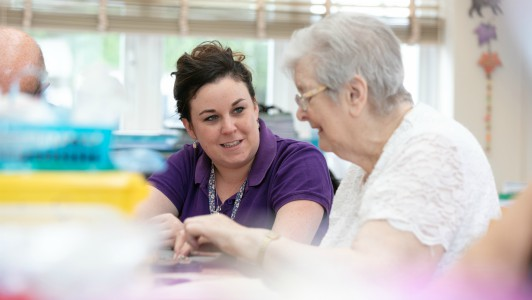 Creative Therapist Lizzie with a patient in Day Hospice