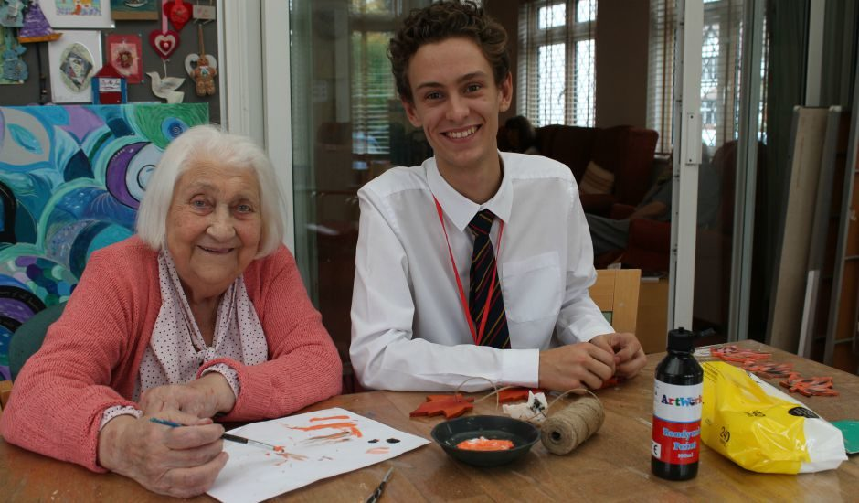 Volunteer Ollie with a Day Hospice patient