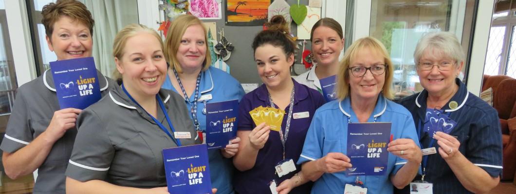Fair Havens Nursing Staff holding Light Up A Life Leaflets