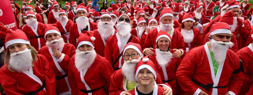 A crowd of people dressed as Santa