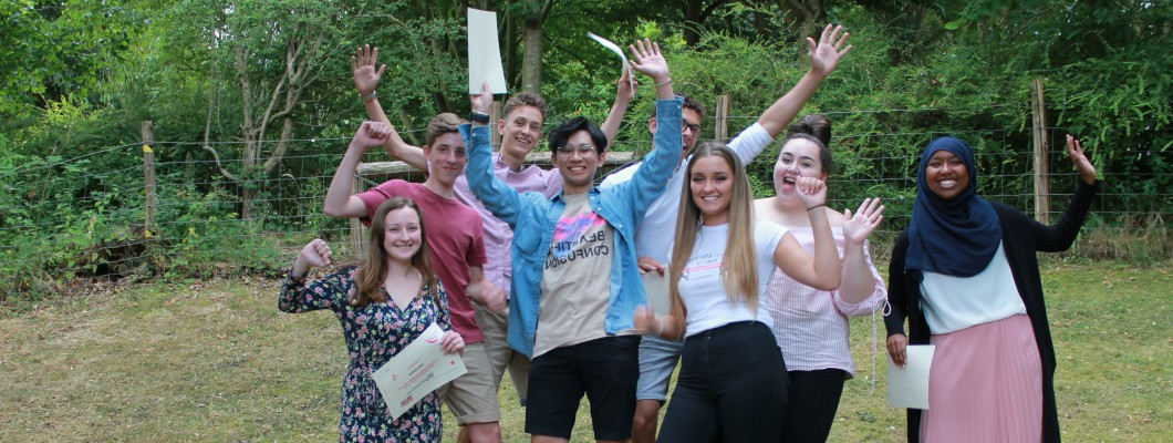 a group of eight Young Ambassador volunteers jumping in the air in celebration