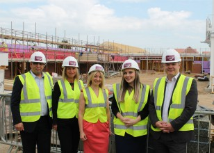 corporate supporters standing in front of the new Fair Havens building site
