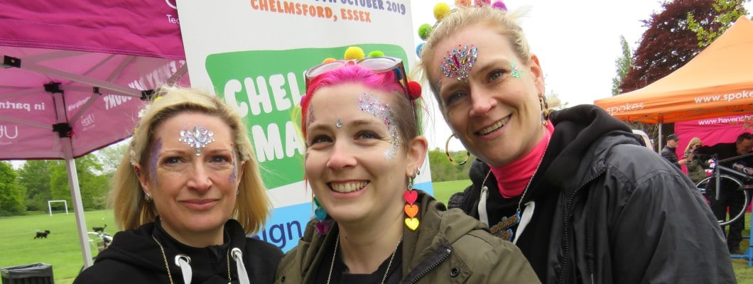 Three fundraisers with glitter on their faces