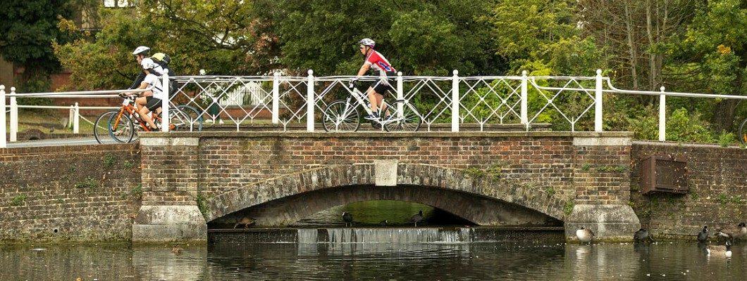 cyclists riding over a bridge