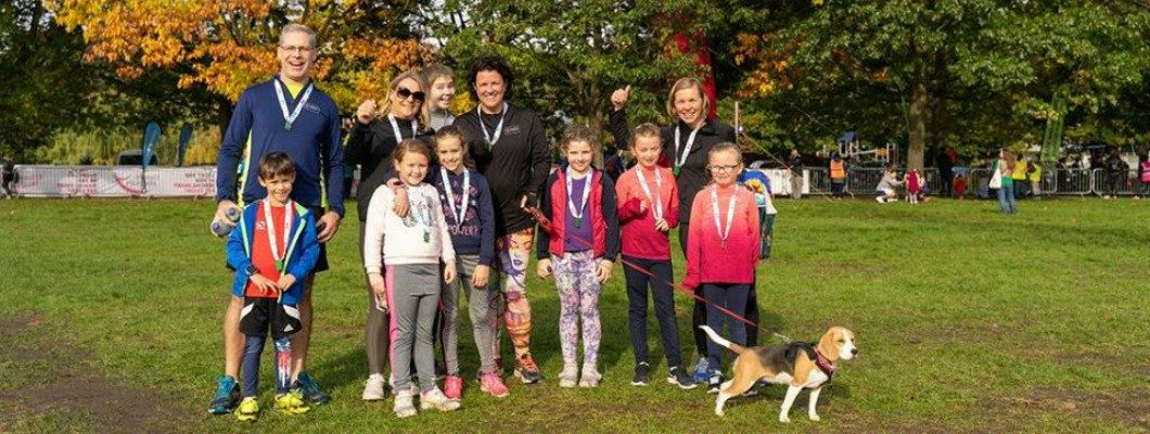 Family and their dog take part in the 3k Fun Run
