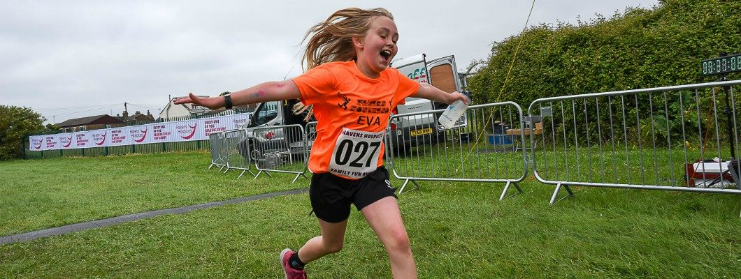 young Havens Hospices supporter running with arms out