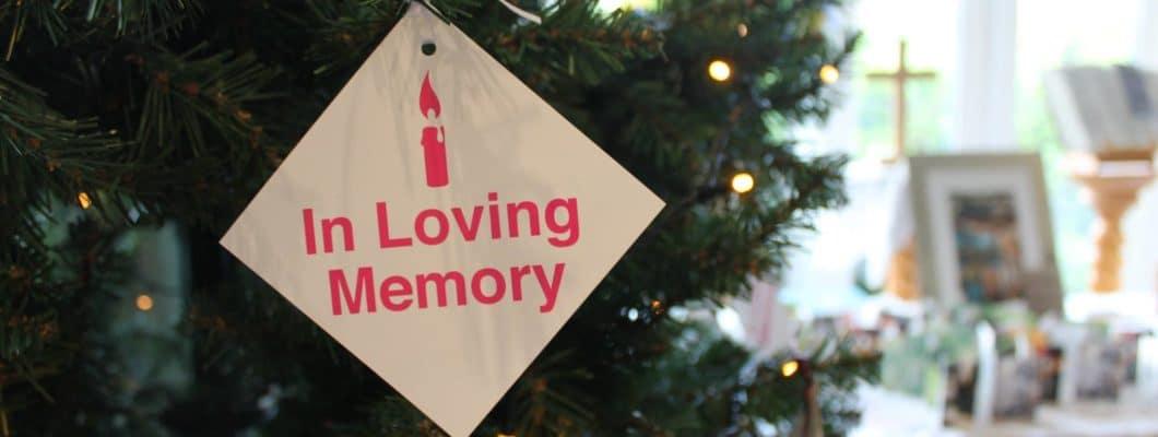 In loving memory take hanging on christmas tree