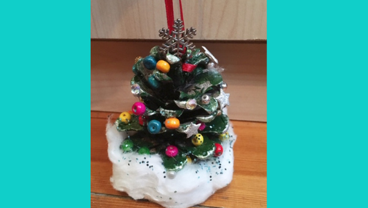 pine cone painted green and decorated to look like christmas tree