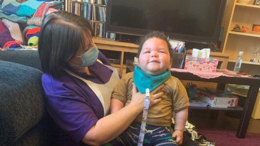 Elijah with nurse