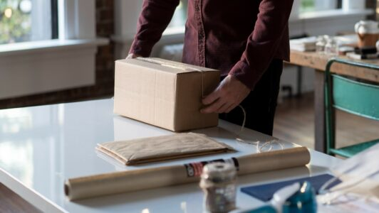 Person packing up a box